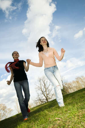 happy girls running in the open air Stock Photo - 3071210