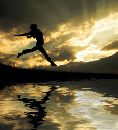 a jumping girl on the sunset background  Stock Photo - 3071102