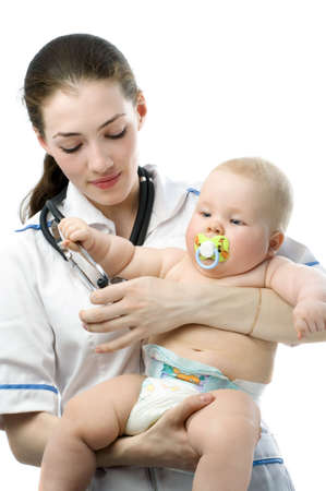 a doctor holding a baby on the hands photo