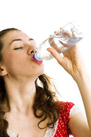 thirsty: a thirsty girl drinking cold pure water Stock Photo