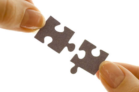 pieces of the jigsaw puzzle fitted together Stock Photo