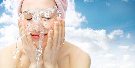 nice girl: young nice girl is washing wis water