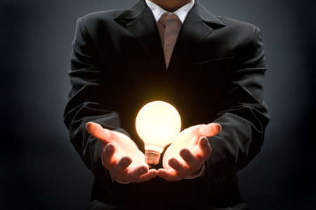 a man pointing to the illuminated bulb Stock Photo - 3509627