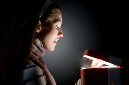 a beautifull girl opening  x-mass magic present Stock Photo - 3654405