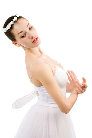 gracefully: a young wonderful ballerina is dancing gracefully