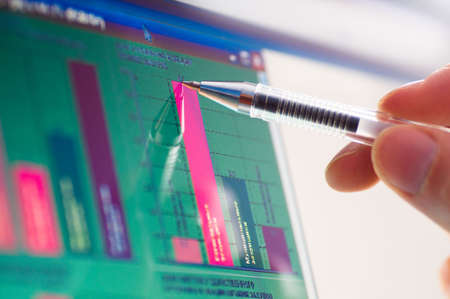 by the lcd screen: business analyze - closeup on lcd screen