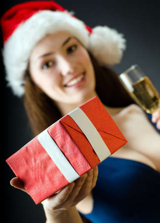 young girl with christmas present in hands photo