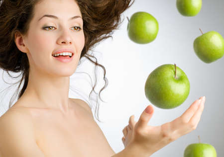 a girl with a ripe green apple photo
