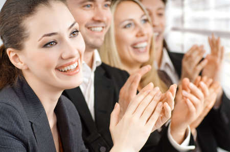 conventions: team of successful smiling young business people