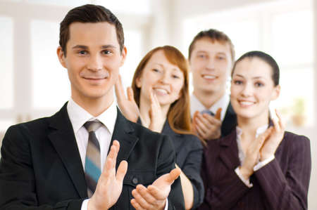 team of successful smiling young business people Stock Photo - 4569454
