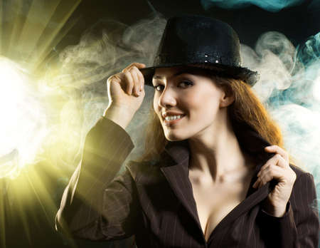 girl in the smoke enlightened with spotlights photo