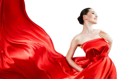 beautiful young woman in red long dress Stock Photo - 5024568