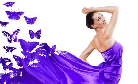 beautiful young woman in purple long dress photo