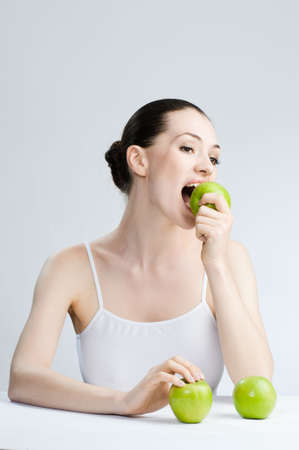 A beautiful slender girl eating healthy food Stock Photo - 5069085