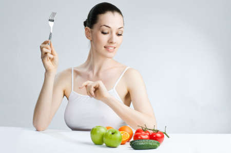 A beautiful slender girl eating healthy food photo