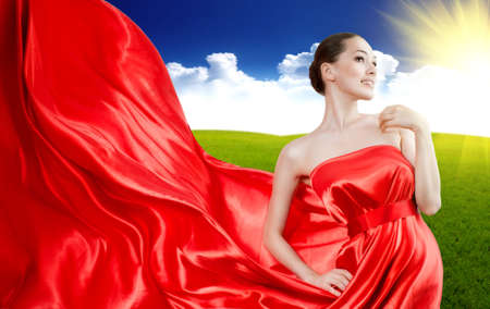 beautiful young woman in red long dress photo
