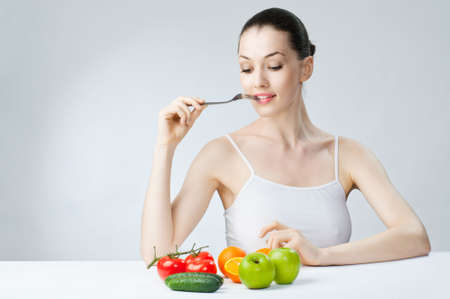 A beautiful slender girl eating healthy food Stock Photo