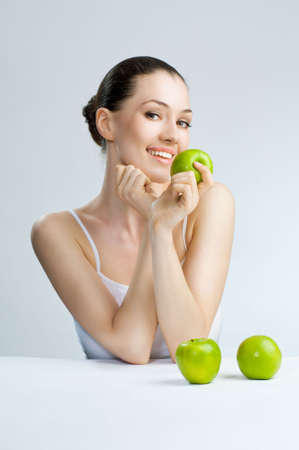 A beautiful slender girl eating healthy food Stock Photo - 5093587