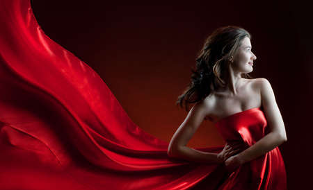 beautiful young woman in red long dress photo