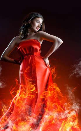 beautiful young woman in red long dress Stock Photo - 5144757
