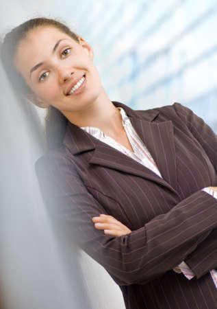 positivist: a beautiful business woman enjoying her success