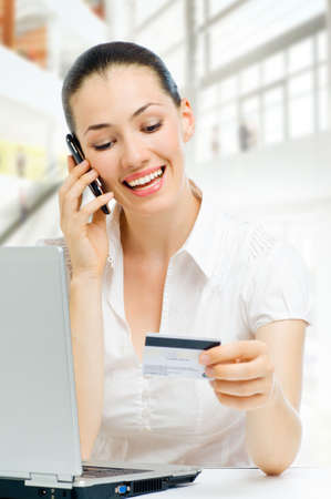 Portrait of a young woman shopping online photo
