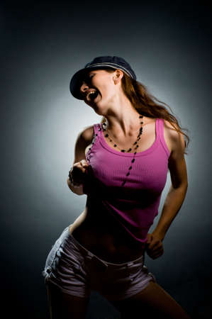 a young nice girl dancing modern dances Stock Photo - 5551509
