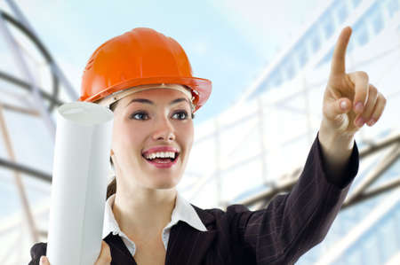 a beautiful young architector in a hardhat photo