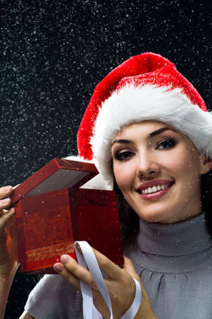 miraculous: young girl with christmas present in hands Stock Photo