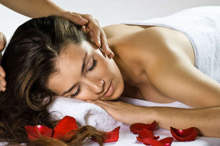 a young beautiful girl is being massaged photo