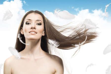 a beauty girl on the sky background Stock Photo - 5840044