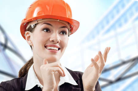 architector: a beautiful young architector in a hardhat