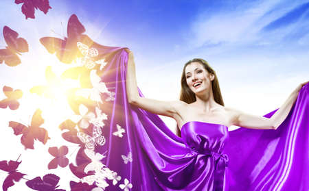 wind dress: beautiful young woman in purple long dress Stock Photo