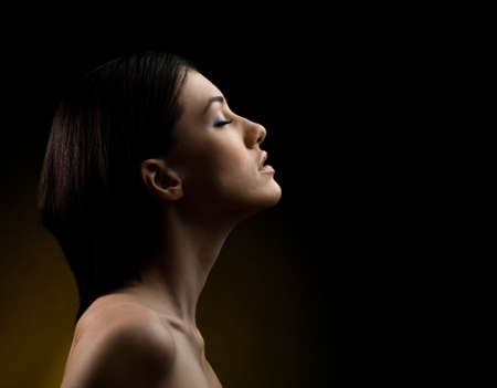 a beauty girl on the dark background photo