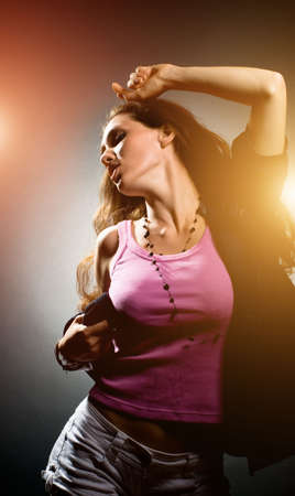 a young nice girl dancing modern dances Stock Photo - 6067930