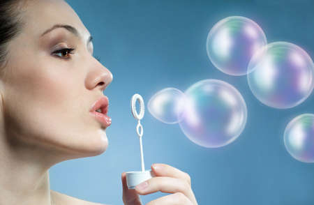 a beauty young woman blowing soap bubbles Stock Photo - 6376058