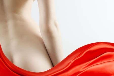 nalga: una nalgas de belleza sobre un fondo blanco