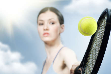 Beautiful sporty girl playing tennis very passionately Stock Photo - 6789089