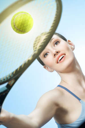 Beautiful sporty girl playing tennis very passionately Stock Photo - 6789140