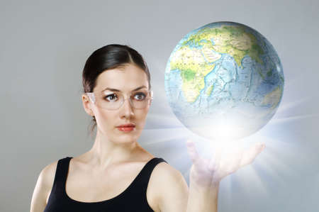 woman holding a globe in her hand photo