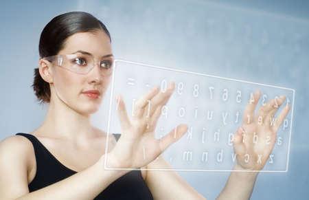 Close-up of secretary's hand touching computer keys  photo