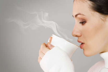 Woman with an aromatic coffee in hands Stock Photo - 7010597