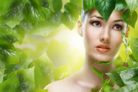 a beauty girl on the leaves background photo