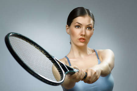 passionately: Beautiful sporty girl playing tennis very passionately Stock Photo
