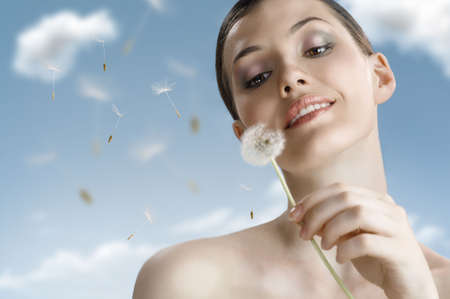 beautiful smiling girl with dandelion in hand Stock Photo - 7253925