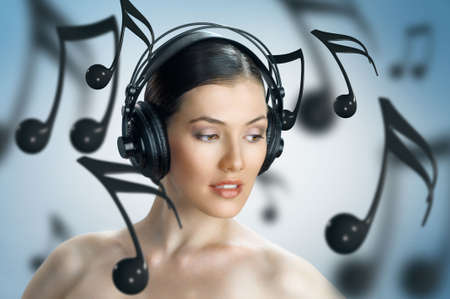 girl with headphones on the blue background photo