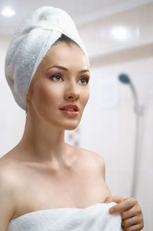 head on shoulder: a beautiful girl wrapped in the bathtowel