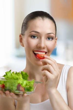 A beautiful slender girl eating healthy food photo