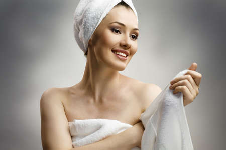a beautiful girl wrapped in the bathtowel photo