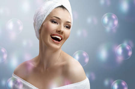 a beautiful girl wrapped in the bathtowel Stock Photo - 7435552